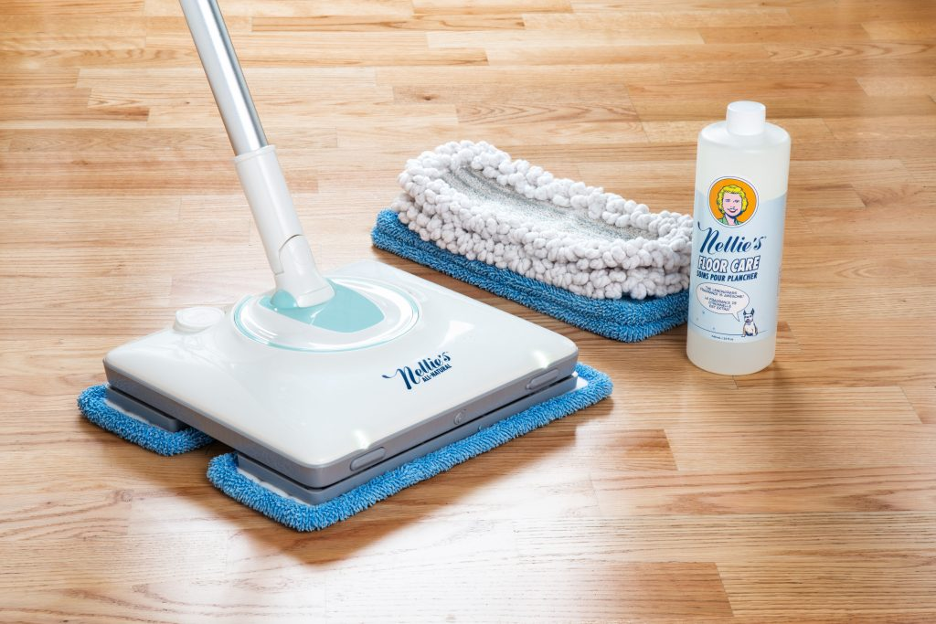 Nellie's WOW Mop, cleaning pads & floor car solution displayed on hardwood floors