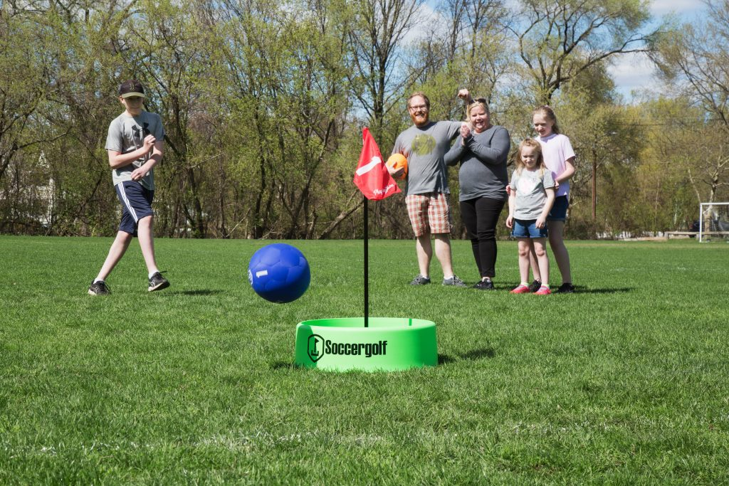 family playing with Soccergold Indoor/Outdoor Footgolf set