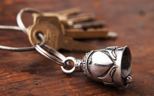 A claddagh symbol is seen depicted on a pewter good luck bell from Guardian Bells, clipped to a keyring