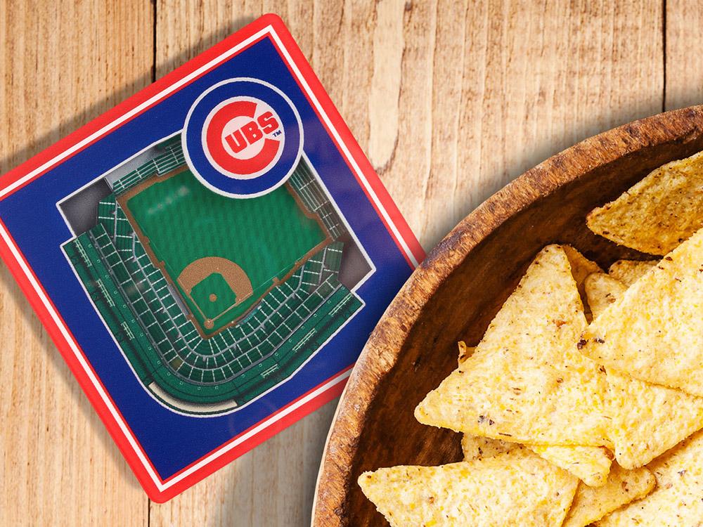 A 3D stadium coaster for the Chicago Cubs from StadiumViews sits next to a bowl of tortilla chips
