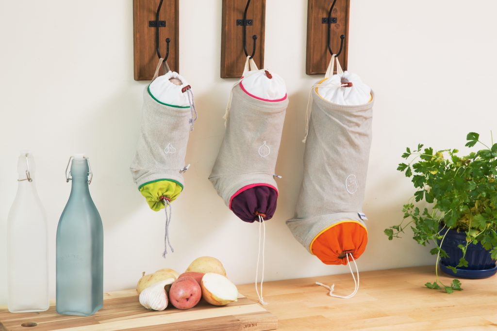 taupe canvas root vegetable keep sacks from Mastrad hang on a wall