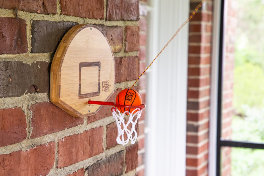 Basketball fans will love practicing their jump shot with this free shot version of Tiki Toss