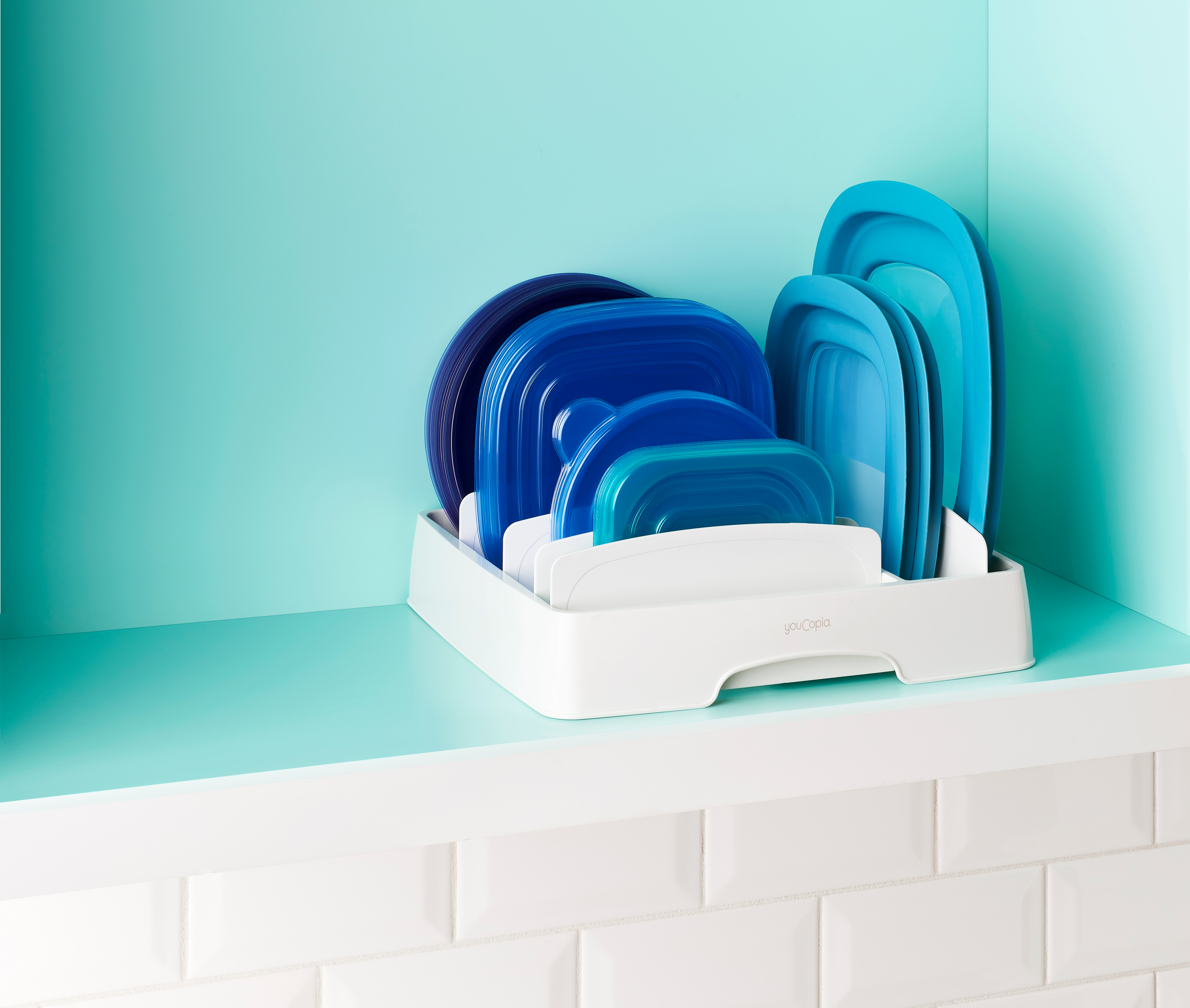 Plastic food container lids are organized neatly with YouCopia's Storalid lid organizer