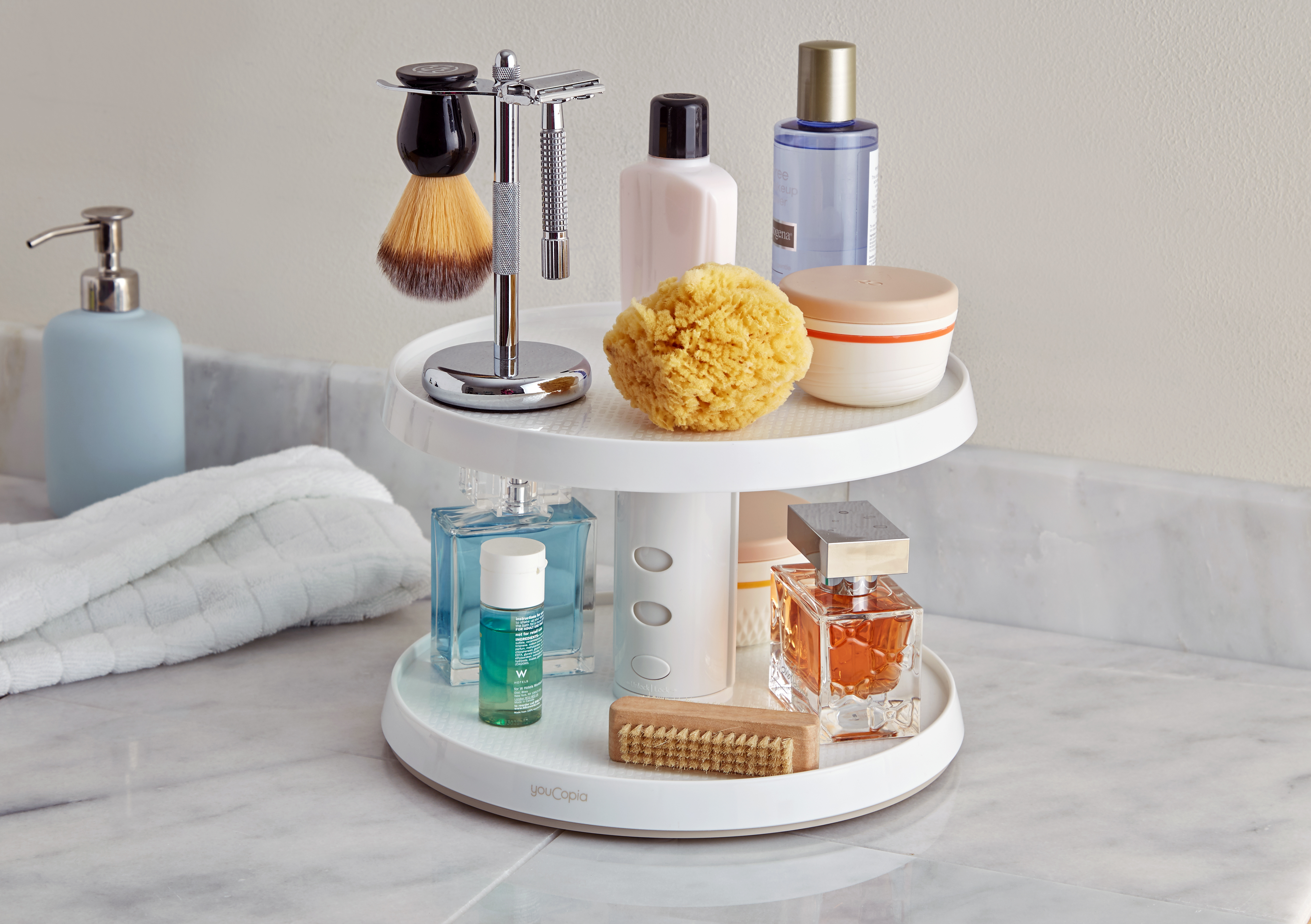 Toiletries are organized neatly on YouCopia's  Crazy Susan 2-tier turntable