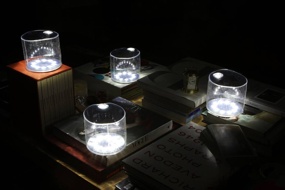 Four Luci by MPOWERD inflatable solar lanterns are seen lighting up a dark space
