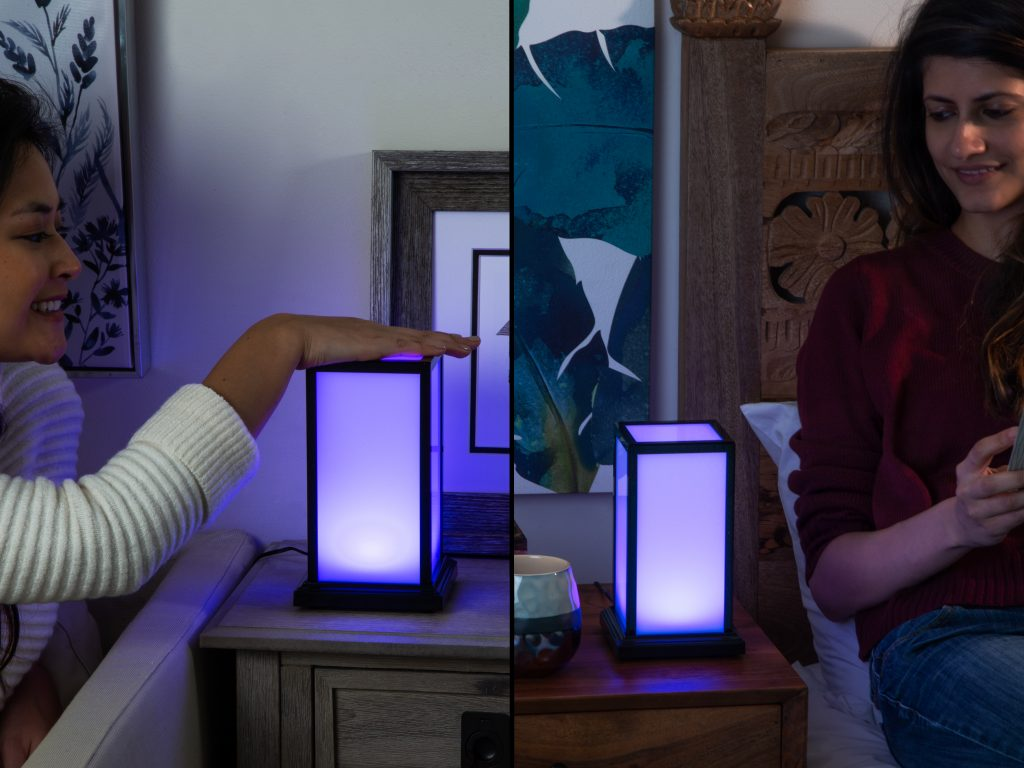 Two friends are seen touching their long distance friendship lamps from Filimin to let each other know they're thinking of the other
