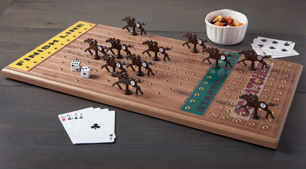 Cards & dice are seen used to play Across the Board's wooden tabletop horseracing game