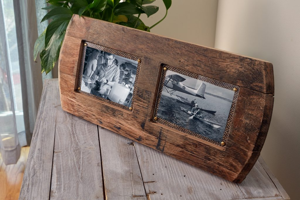 Photos of friends in action are seen sitting in a reclaimed whisky barrel double frame from Whisky Frames