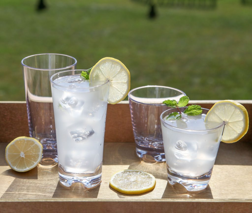 Refreshing summer cocktails sit in unbreakable glasses from BarLuxe