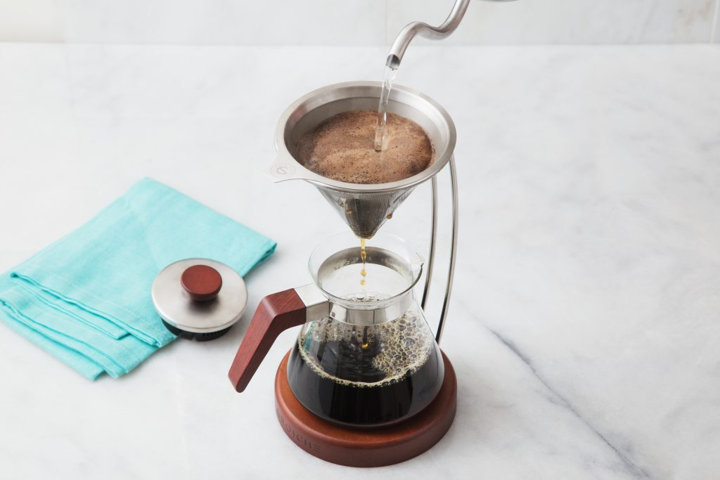 Pour over coffee is seen being made in an elegant Grosche coffee brewer system