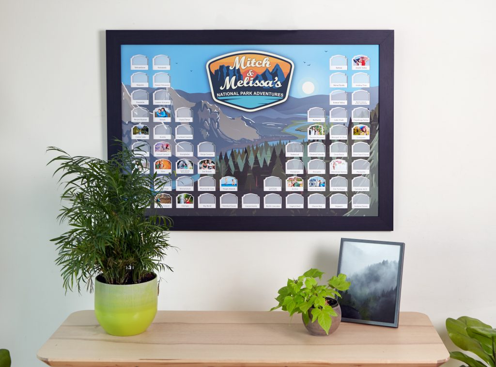 Mitch & Melissa's personalized National Parks photo map from Thunder Bunny Labs hangs on a wall above a side table