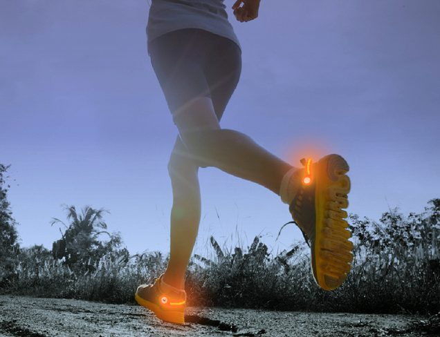A person is seen running at night wearing red heel lights on their sneakers from PowerSpurz
