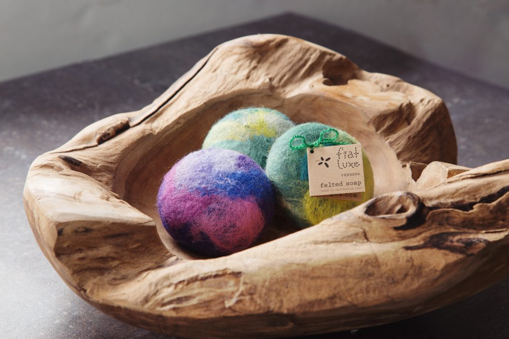 3 Fiat Luxe felted soaps sit in a wooden bowl