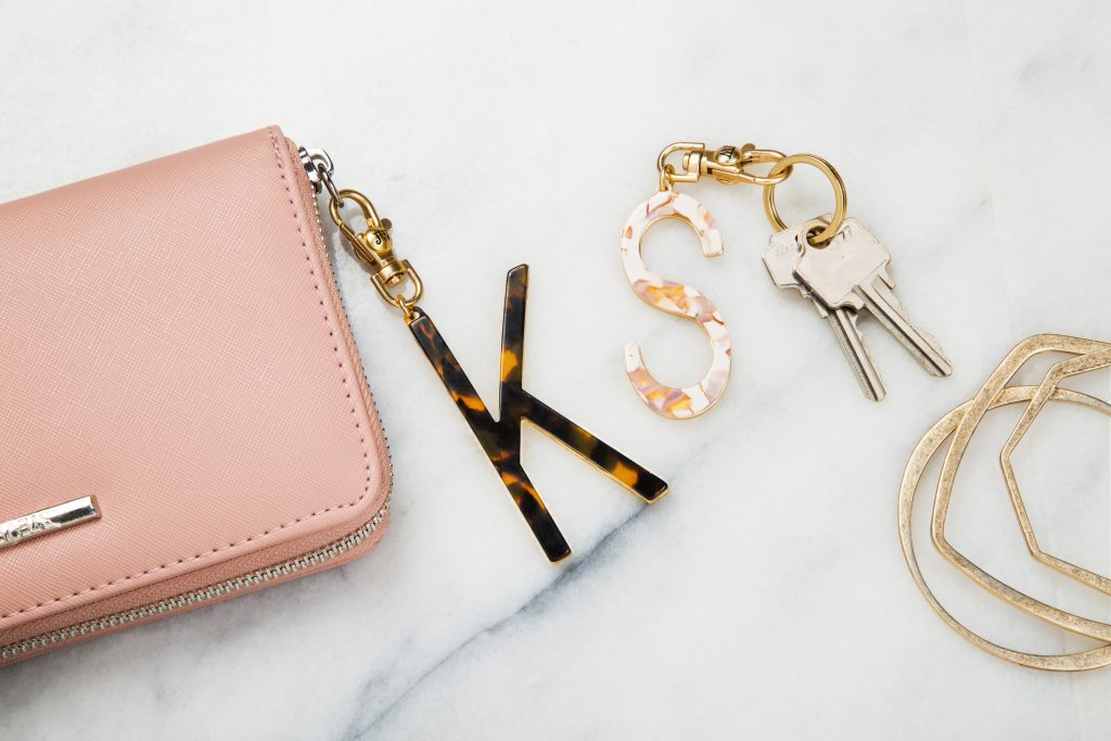 Tortoiseshell initial keychains from John Windare hooked to a wristlet and keys